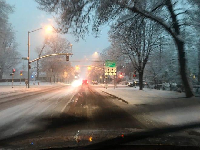 Heavy wet snow falls on Main Street in Burlington on Tuesday, Nov. 27, 2018.
