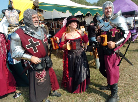 Sir Ruben Anthony (left);  Lady Tenelle;  Sir Robert;  all dressed in 14th. century European garments at the Ingleside Renaissance Faire.