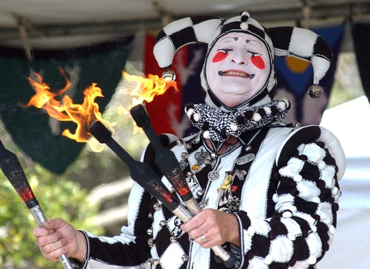 """Marguise of Marguise & Imanutte perform tricks with fire and tell fool hearty jokes and skits called """"Fool Hearty"""" at the Ingleside Renaissance Faire."""