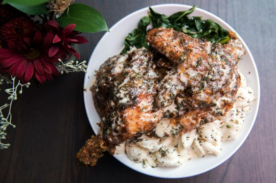 A half chicken entree featuring butter milk fried chicken, smokey collard greens, house made macaroni & cheese and coleslaw dressing from The Farmacy NJ in Palmyra..
