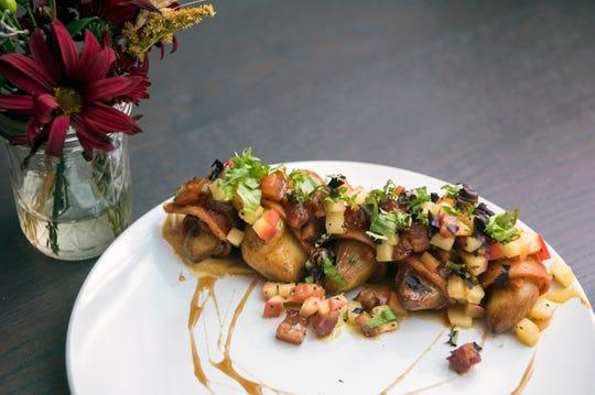 A Fingerling Fritter appetizer with roasted potatoes, smoked bacon, Gala apples, dijon mustard and an apple cider reduction from The Farmacy NJ in Palmyra.