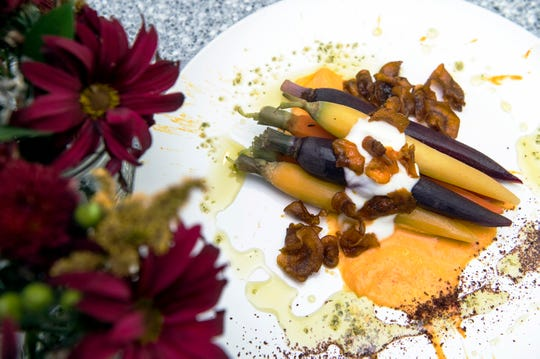 Oven roasted heirloom carrots with a spicy carrot puree, fried carrot chips, Greek yogurt, carrot top pesto and sumac from The Farmacy NJ in Palmyra.