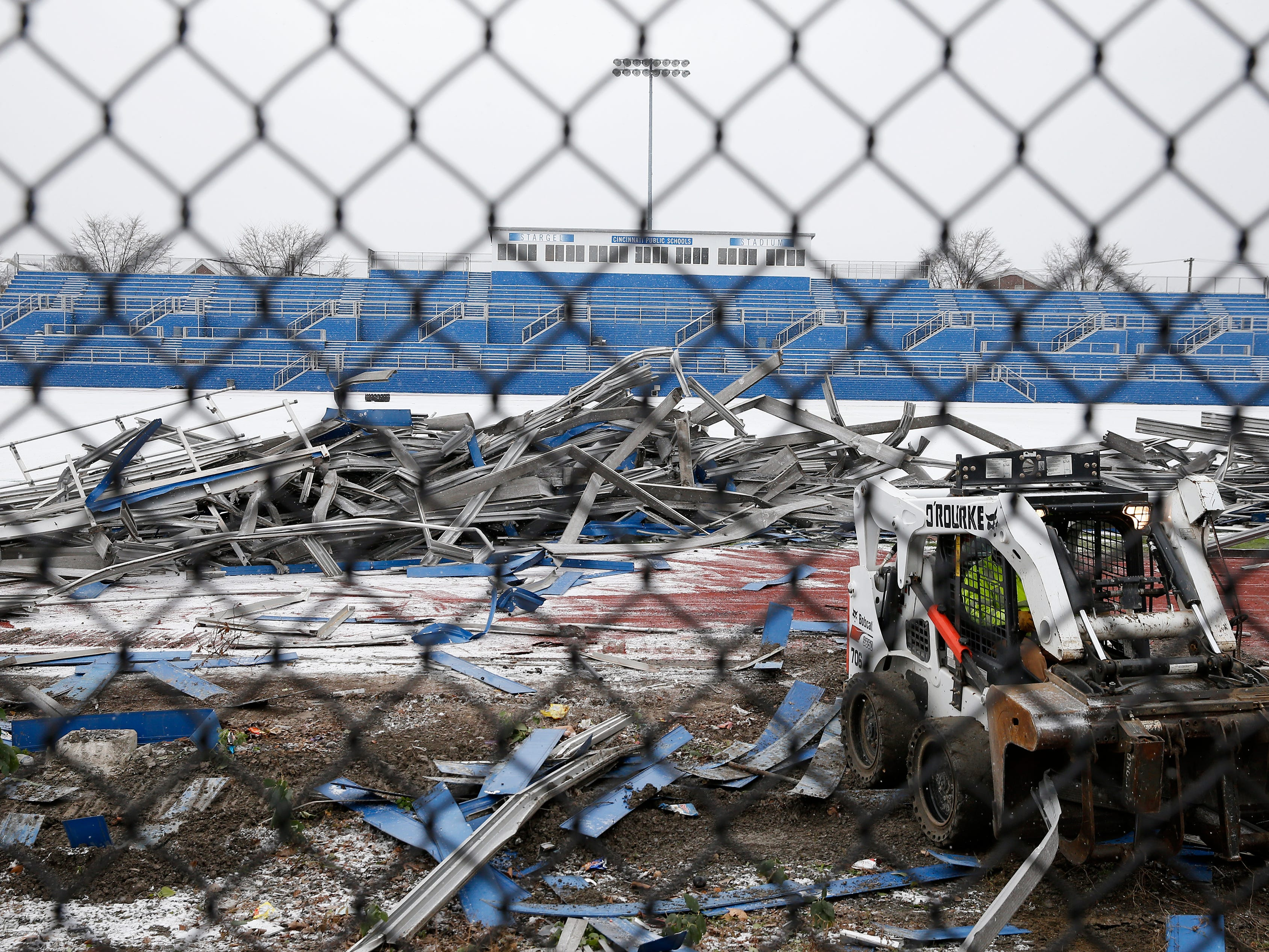 The home bleachers at Stargel Stadium is all that remains Tuesday morning as the visitor's bleachers are torn down to make way for the FC Cincinnati stadium in the West End.