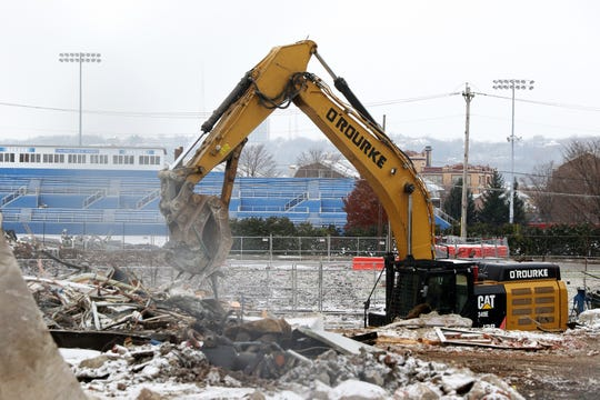 Buildings are torn down near Stargel Stadium Tuesday November 27, 2018 to make way for the FC Cincinnati stadium in the West End.