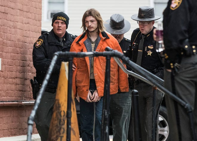 """Edward """"Jake"""" Wagner, 26, of South Webster is escorted into the back of the Pike County Courthouse by police on Tuesday, November 27, 2018, in Waverly, Ohio. Jake Wagner is facing murder charges, along with his brother George Wagner IV and parents George """"Billy"""" Wagner III and Angela Wagner, relating to the deaths of seven Rhoden family members and Hannah Gilley over a possible custody dispute.  Jake Wagner is the father of Hannah Rhoden's older daughter and possibly her youngest child. The eight homicides took place in April of 2016 at four different homes, all around the same time, and it would spawn the largest homicide investigation in Ohio history. If convicted, all are facing the death penalty."""