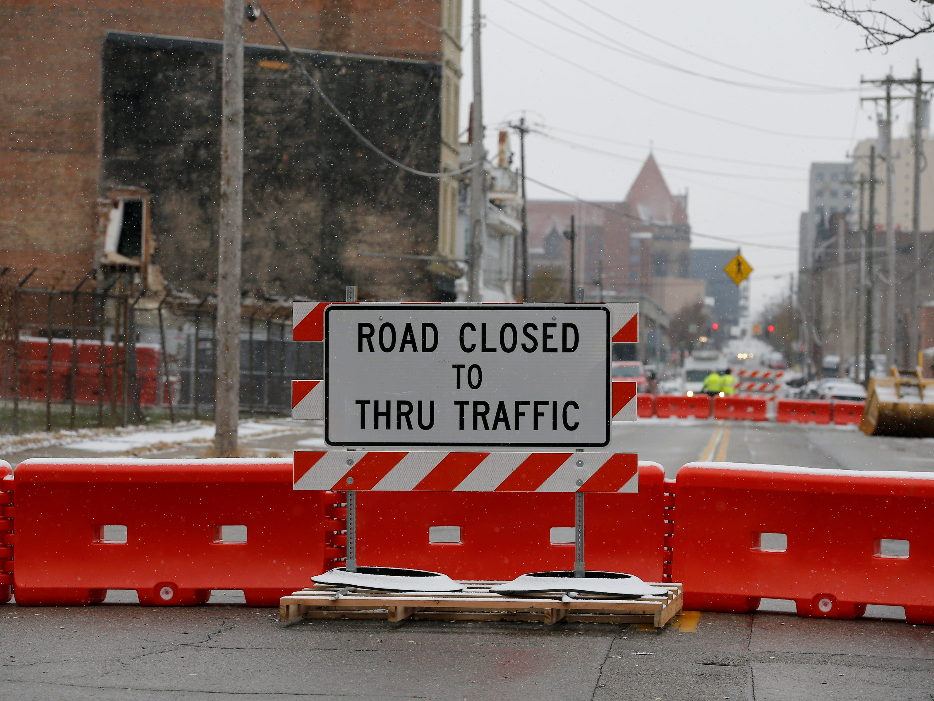 The road is closed at Central Avenue and Wade Street as buildings  are torn down Tuesday November 27, 2018 to make way for the FC Cincinnati stadium in the West End.