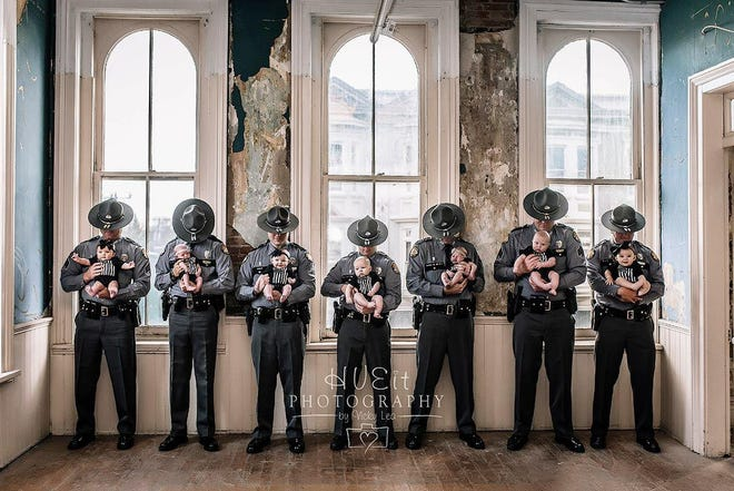 Seven Kentucky State troopers became parents around the same time and had a photo shoot to celebrate.