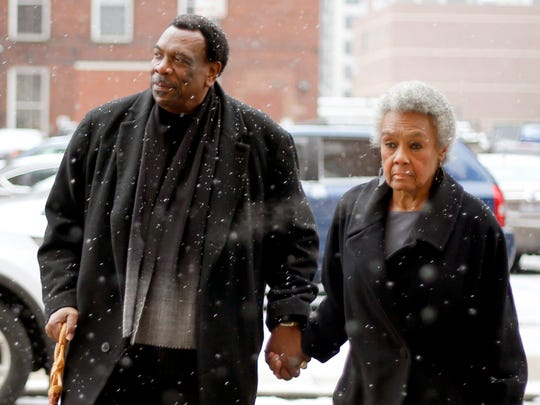 Wendell Young walks with his wife, Kathy Young, into the Hamilton County Prosecutor's Office Tuesday to testify this morning before a grand jury looking into whether the councilman broke theÊlaw by destroying text messages.