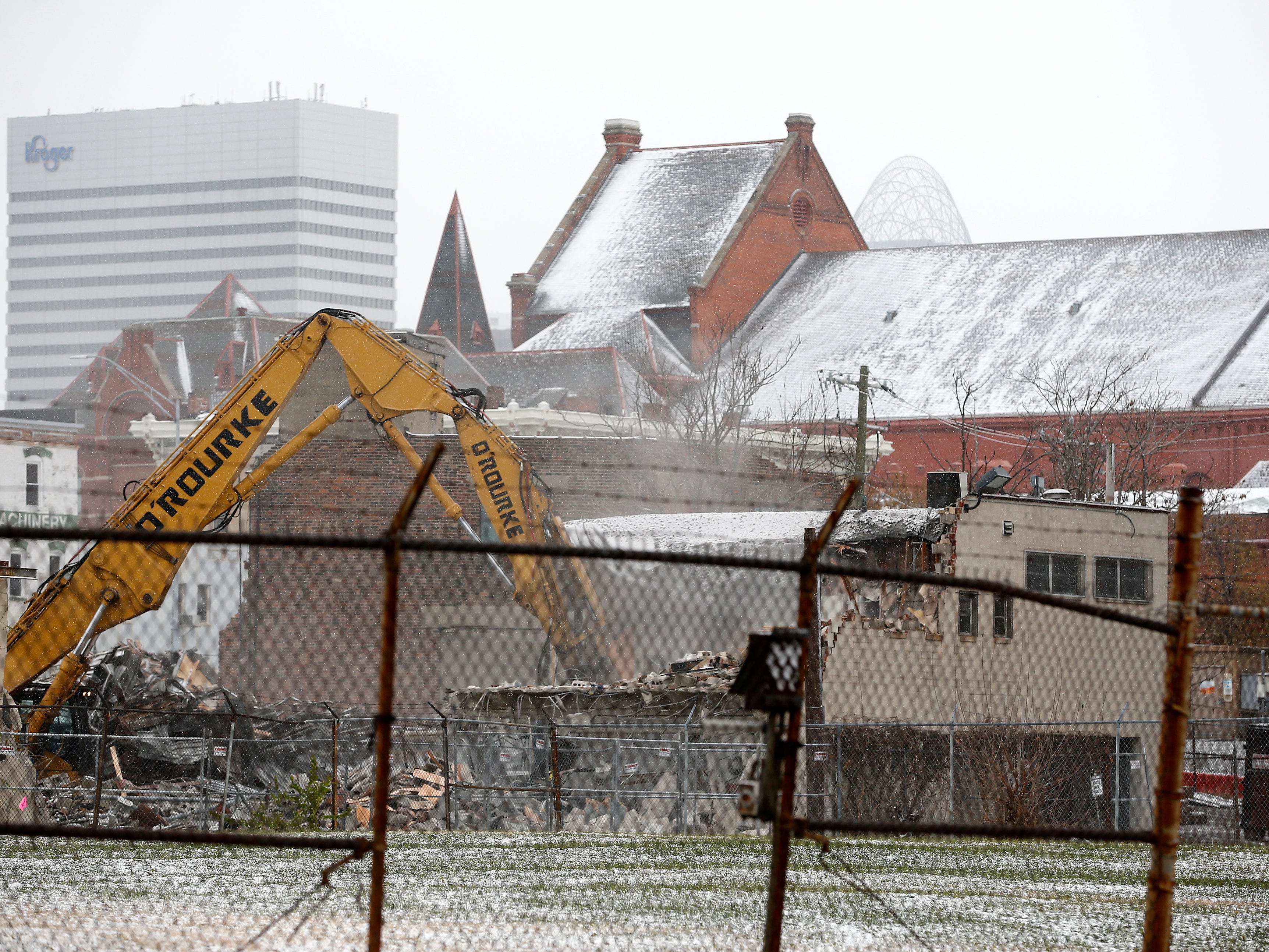Buildings along Central Parkway are torn down Tuesday November 27, 2018 to make way for the FC Cincinnati stadium in the West End.