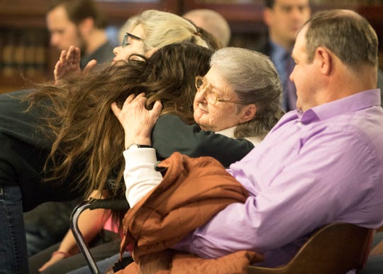 "Hannah Gilley's mom, left, hugs Geneva Rhoden, the mother of Chris Rhoden Sr., before the arraignment of Edward ""Jake"" Wagner at the Pike County Courthouse on Tuesday, Nov. 27, 2018, in Waverly, Ohio. Jake Wagner is facing murder charges, along with his brother George Wagner IV and parents George ""Billy"" Wagner III and Angela Wagner, relating to the deaths of seven Rhoden family members and Hannah Gilley over a possible custody dispute."