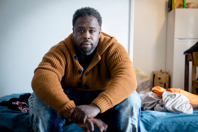 Abdul Shakir Al-Lateef sits inside the Bethany House shelter on Tuesday, Nov. 27, 2018 in Cincinnati. Al-Lateef is the father of nine, seven of whom reside with him.
