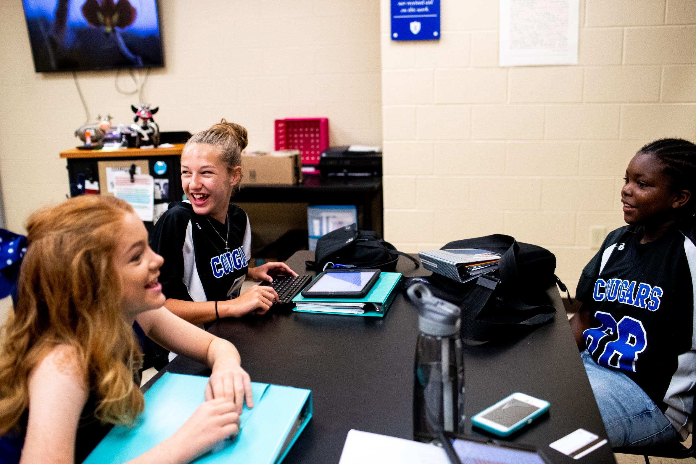 """Elizabeth Cundiff and Madisen Bryant, right, wait for class to begin while wearing their game day jerseys at Clarksville Academy Thursday, Oct. 4, 2018, in Clarksville, Tenn. Madisen feels like they are """"rocking that jersey,"""" where as other people think Elizabeth got the jersey by dating a male football player."""