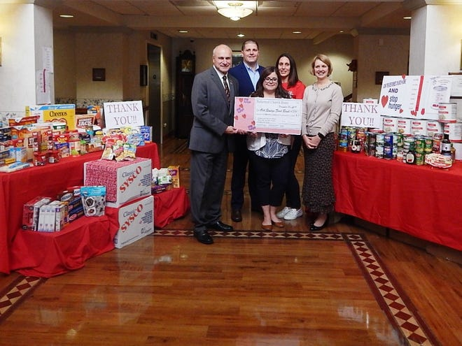 "(Left to right) Old Bridge Mayor Owen Henry, Parks and Recreation Director Matt Mercurio, and Food Bank Manager Anahita Feltz accept food and monetary donations for the Old Bridge Food Bank during a reception at Reformed Church Home. Liz Alioto, RCH Dining Services Director, and Kate Shepard, RCH Executive Director, made the presentation during a brunch reception with residents and staff. The Home collected over $3,500 and more than 500 pounds of food during this year's ""Stop Hunger"" food drive."
