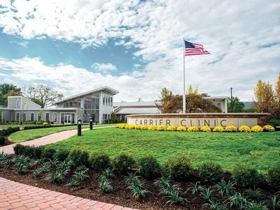 A public hearing will be held Friday on the proposed merger between Carrier Clinic and Hackensack Meridian Health.