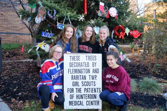 Girl Scouts decorate trees in honor of patients PHOTO CAPTION