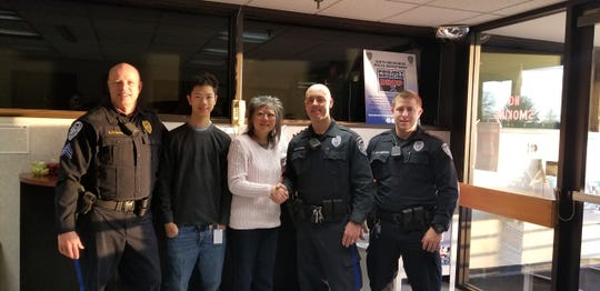 Susan Gong and her son, Connor, thank the South Brunswick police officers Officer Ryan Bartunek, Officer Christopher Magee-Vanderveen, and Sergeant Dan Olsson who helped save the life of her husband Henry Gong when he went into cardiac arrest in September.