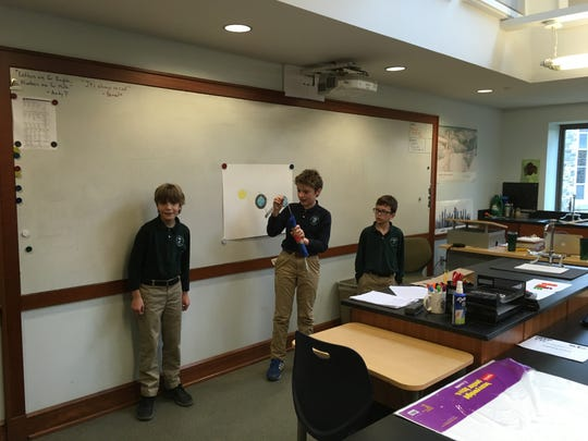 Princeton Academy of the Sacred Heart fifth-graders present their invention to convert emitted methane gas from food waste into energy as part of the National Day of Design challenge.