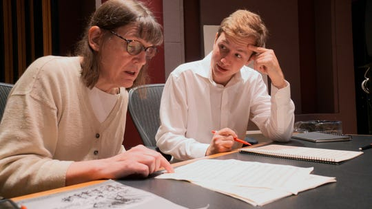"This Nov. 7, 2018, photo, Professor Patricia Hall and graduate student Joshua Devries review the music manuscript for ""The Most Beautiful Time of Life"" at the Duderstadt Center recording studio on campus in Ann Arbor, Mich. The Contemporary Directions Ensemble in October 2018 recorded the music, as it's translated from German to English."