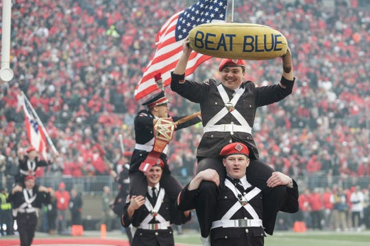 Ohio State marching band celebrates a touchdown against Michigan during the first half at Ohio Stadium in Columbus, Ohio, Saturday, Nov. 24, 2018.