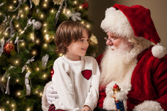 Young Boy In Awe Sits On Santa S Lap