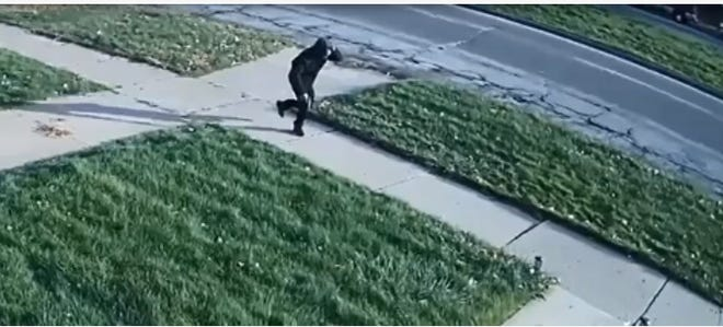 A still image from a video from by the Detroit police of an alleged suspect fleeing the scene of a fatal shooting on Outer Drive in Detroit on Sunday, Nov. 11, 2018.