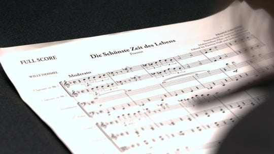 """This Nov. 7, 2018, photo, the full score for""""The Most Beautiful Time of Life (Die Schönste Zeit des Lebens)"""" is shown at the Duderstadt Center recording studio on campus in Ann Arbor, Mich. The music has not been heard since it was arranged and performed by prisoners in a World War II death camp."""