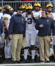 Michigan head coach Jim Harbaugh talks with quarterback Joe Milton and offensive line coach Ed Warinner during the second half against Ohio State, Saturday, Nov. 24, 2018 at Ohio Stadium in Columbus, Ohio.