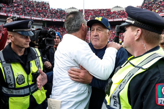 Ohio State head coach Urban Meyer hugs Michigan defensive line coach Greg Mattison after the game at Ohio Stadium in Columbus, Ohio, Saturday, Nov. 24, 2018.
