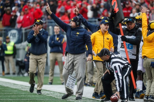 Michigan defensive coordinator Don Brown signals during the first half against Ohio State at Ohio Stadium in Columbus, Ohio, Saturday, Nov. 24, 2018.