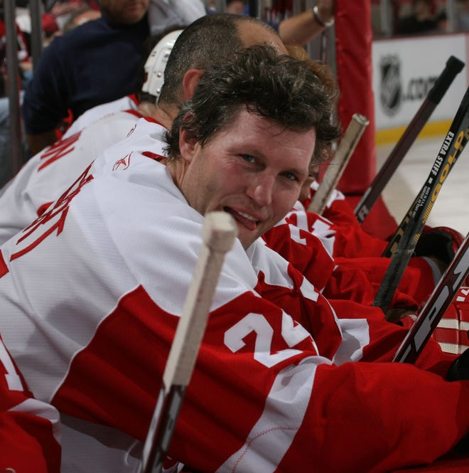 Bob Probert on the bench between shifts of the Detroit Red Wings alumni exhibition game against the Boston Bruins Alumni on Saturday, Jan. 27, 2007, at Joe Louis Arena.