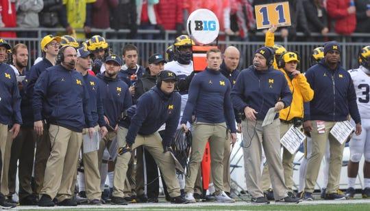 Michigan head coach Jim Harbaugh and his staff during the second half against Ohio State, Nov. 24, 2018 at Ohio Stadium in Columbus, Ohio.