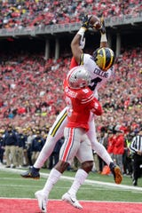 Michigan wide receiver Nico Collins makes a TD catch over Ohio State cornerback Kendall Sheffield during the second half at Ohio Stadium in Columbus, Ohio, Saturday, Nov. 24, 2018.