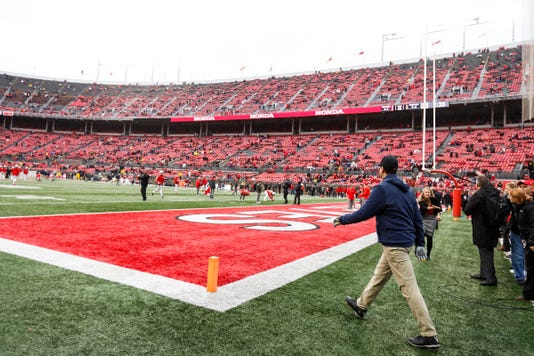 Jim Harbaugh takes the field Ohio State