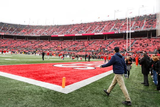 Michigan head coach Jim Harbaugh walks onto the field before the game at Ohio Stadium in Columbus, Ohio, Saturday, Nov. 24, 2018.