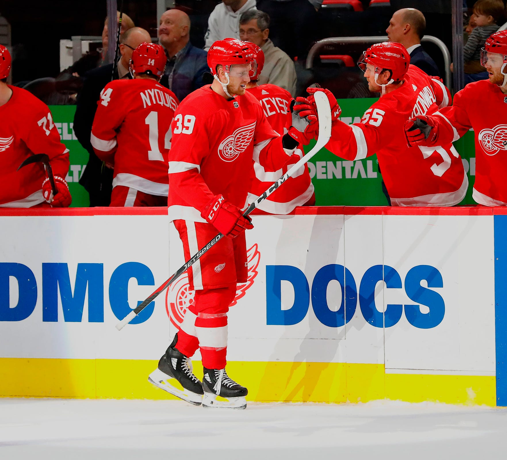 Red Wings right wing Anthony Mantha is congratulated by teammates after scoring in the third period of the Wings' 7-5 loss to the Blue Jackets on Monday, Nov. 26, 2018, at Little Caesars Arena.