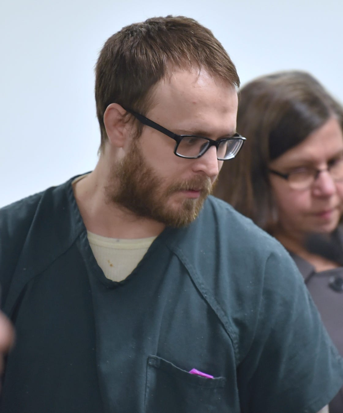 Defendant Daniel Michalak enters the courtroom Tuesday for a preliminary hearing. He faces multiple charges in the death of his  girlfriend, Tia Marie Vellucci, at the MGM Grand Casino Hotel in Detroit.
