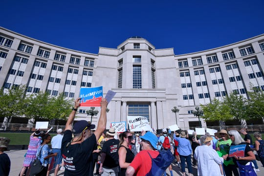 Over 100 demonstrators rally outside the Michigan Hall of Justice Wednesday, July 18, 2018, where the Michigan Supreme Court heard arguments on whether the constitution should be amended by voters to change the way political districts are made.