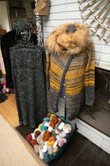 Jones knitted this skit and cardigan with removable Mongolian lamb collar.