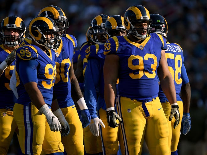 Aaron Donald (99) and Ndamukong Suh (93) will come to Detroit this weekend and show the Lions just what they're missing.