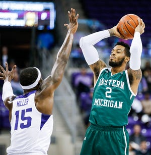 Eastern Michigan forward James Thompson IV (2) looks for room against TCU forward JD Miller (15) during the first half.