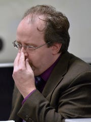 Wayne County Assistant Medical Examiner Dr. David Moons touches his nose as he testifies to the gruesome injuries victim Tia Marie Vellucci sustained, including having the tip of her nose bitten off.