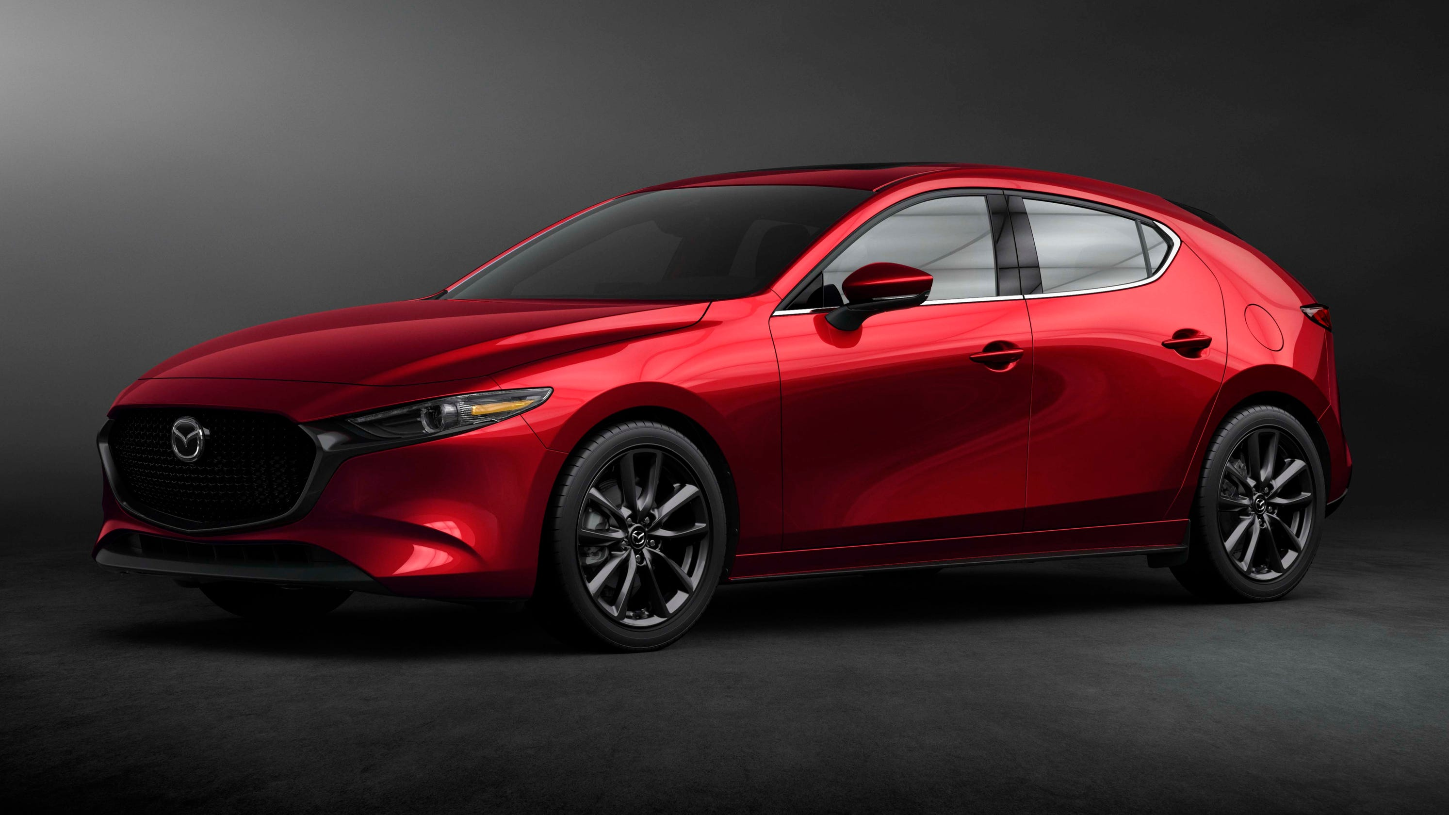 La Show Mazda 3 And Toyota Prius Compacts Make Their Debut