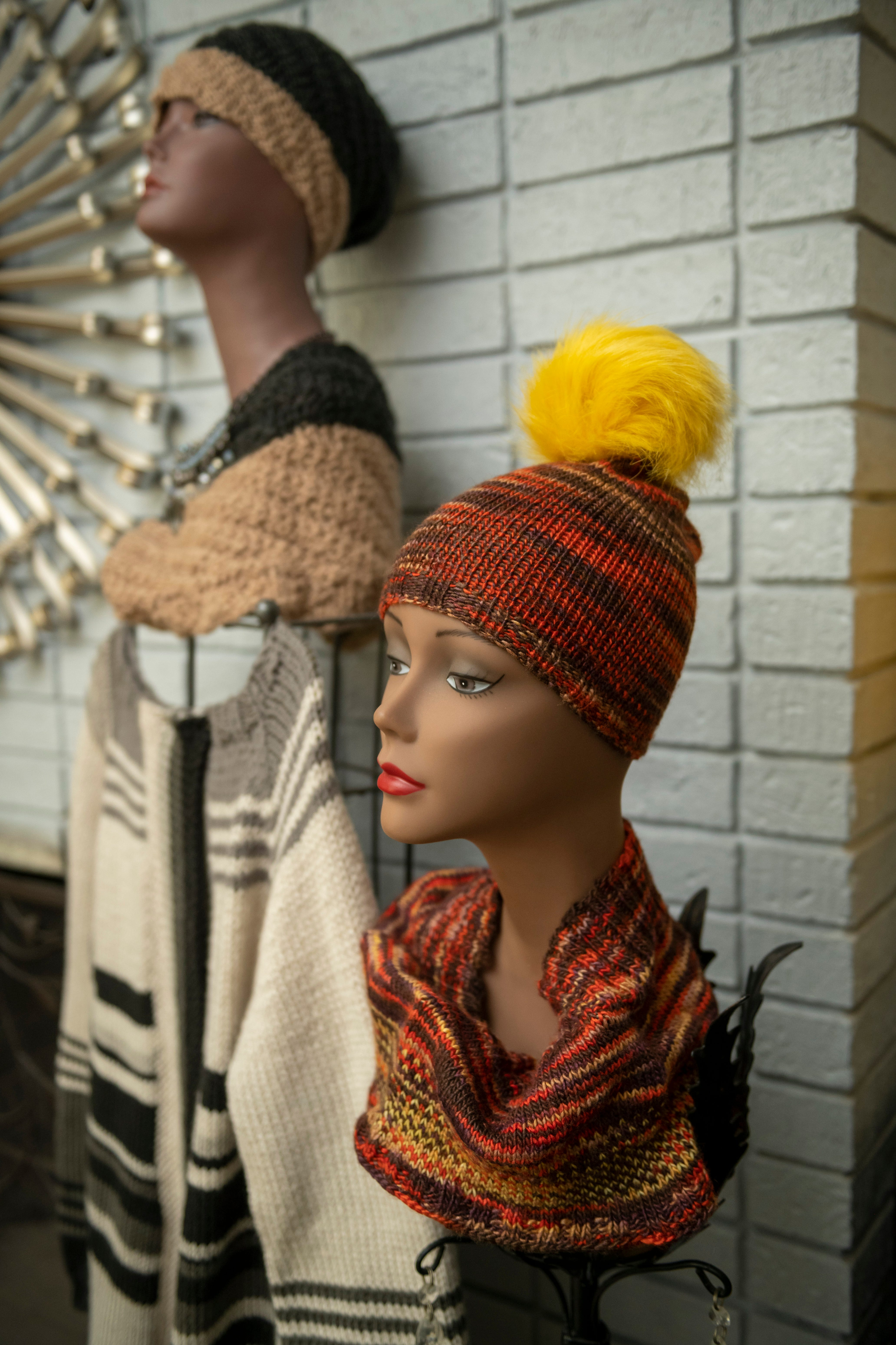 Cowls and a hat with a pom pom are some of the hand knitted items Jones has crafted.