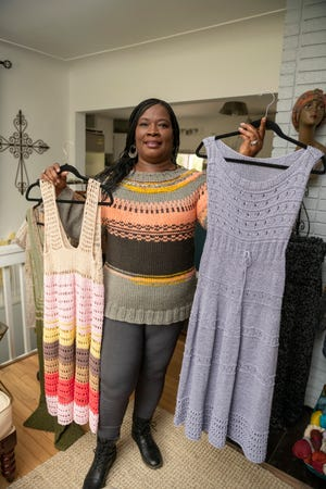 Gwendolyn R. Jones holds a crocheted beach coverup, left, and a knit dress while wearing a top down Fair isle knitted sweater, which she also made.