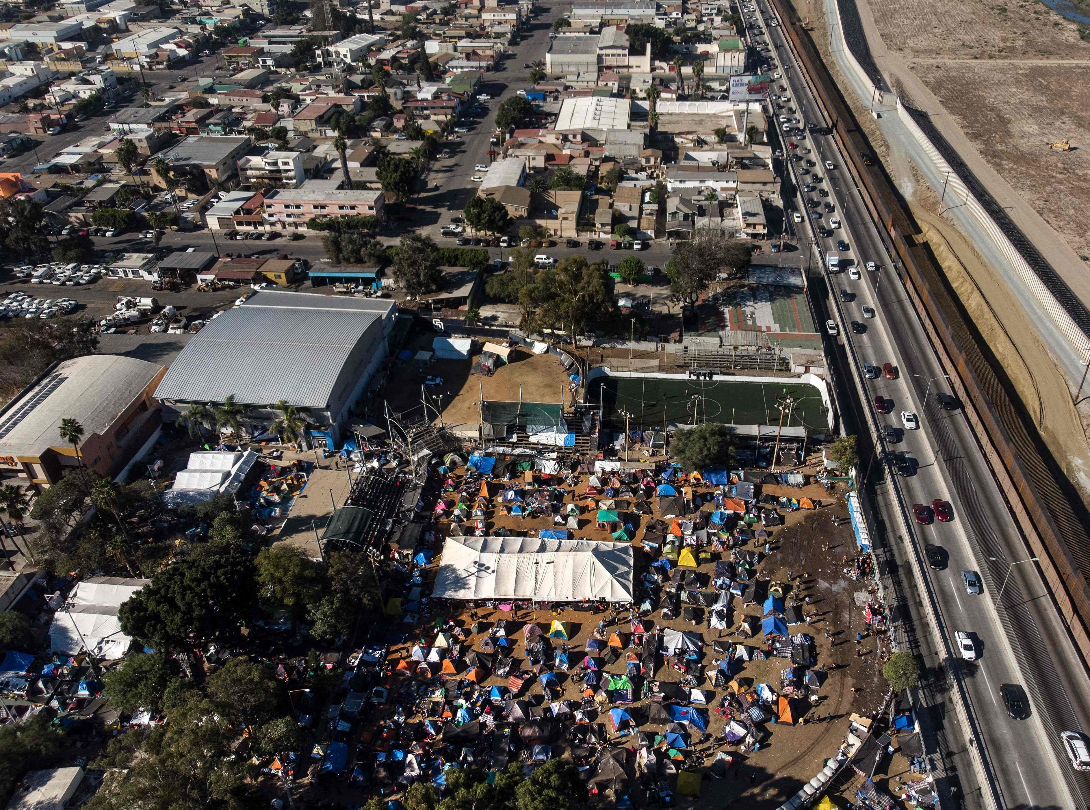 This is a temporary shelter where Central American migrants -- mostly from Honduras -- are staying in Tijuana, Baja California State, Mexico, on November 27, 2018. After a trek of more than a month from Honduras, nearly 5,000 migrants -- including women and children -- are now in Tijuana living in a makeshift shelter.