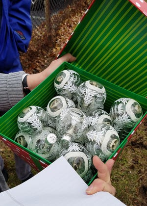 A donation to Easterseals was made in the form of $100 bills inside clear ornaments.