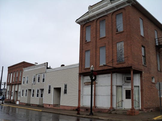 File photo taken in November, 2019, of the 300 block of North Main Street in Clyde. The property was purchased by the city earlier this year and the century-old buildings were demolished this week.