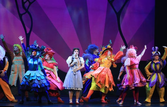 """Dorothy (Kalie Kaimann) visits Munchkinland in this scene from Prather Touring Company's """"The Wizard of Oz"""""""