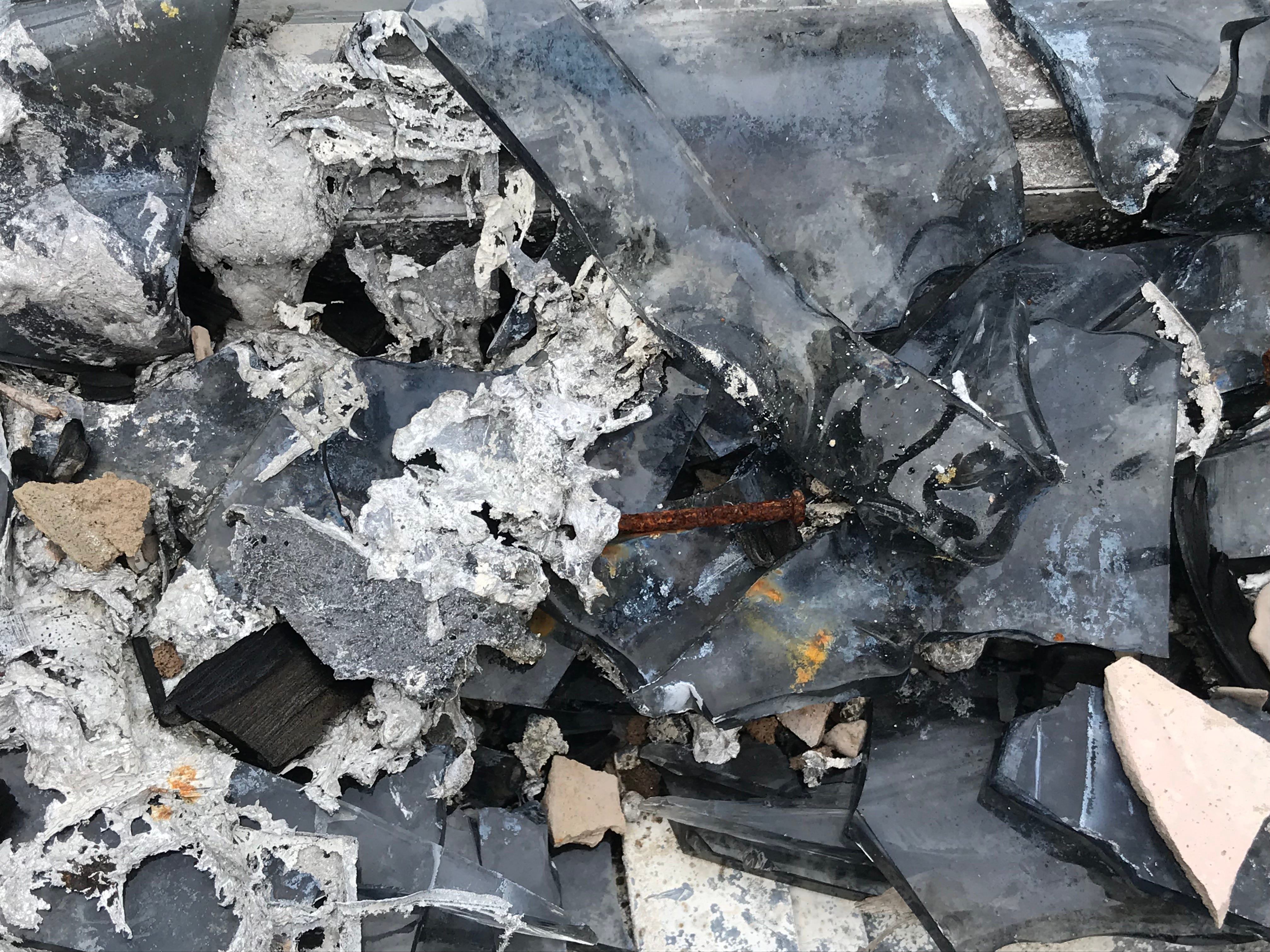 Eight months after fire raced through a 25-acre section of woods south of Briarcliff Lane in south Fort Myers Henry Andreasen's home — the only dwelling destroyed — remains a scorched shell surrounded by piles of rusted and broken debris.