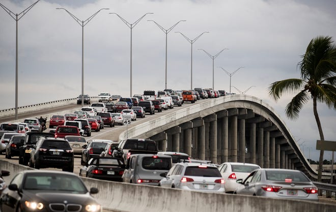 Morning rush hour bridge traffic as suburban commuters from Cape Coral head over the Cape Coral Bridge to work or school in Fort Myers and adjacent unincorporated Lee County in this 2018 file photo.